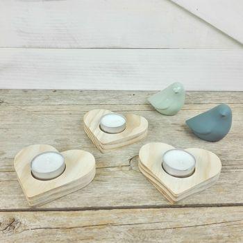 corazones de madera portavelas
